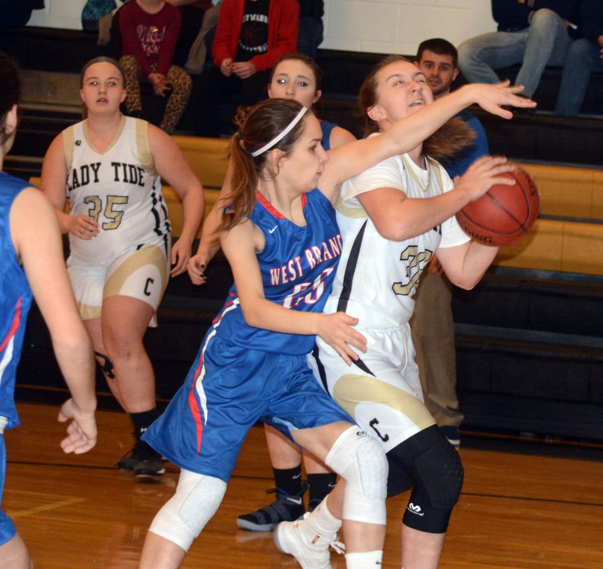 WB's Emily White blocks a shot of a Curwensville player