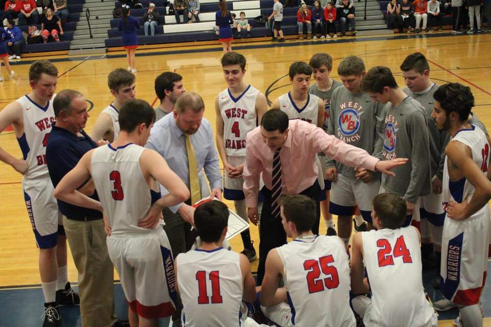 Coach Clark addresses the team during a timeout during a home game against Mount Union.