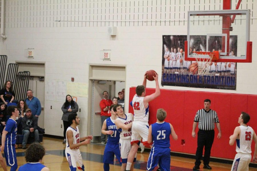 Dalton Kristofits drives down the lane during a playoff game against United.