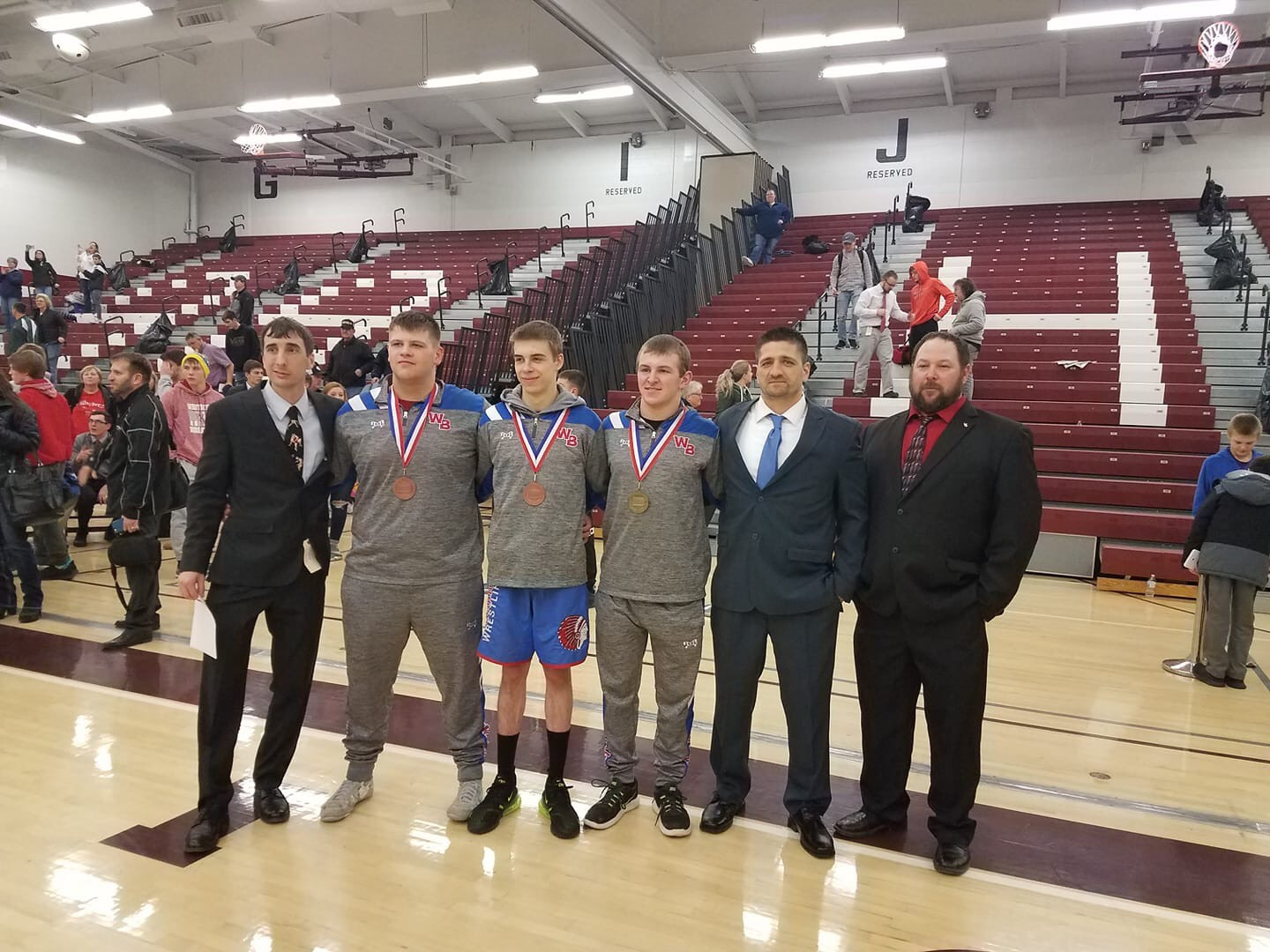 The Warrior Wrestlers and their coaches. (From left to right) Dave Williamson, Jacob Shaw, Tyler Denochick, Derek Yingling, Coach Bainey, George Yingling Photo courtesy of West Branch Warriors Wrestling.