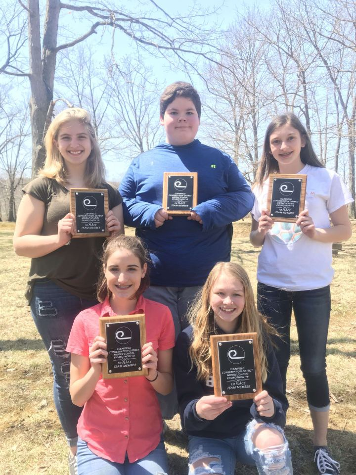 Katlyn Folmar, Noah Fry, Paige Washic, Olivia Blasko, and Rylee Sabol smile after winning first place at the county competition in 2018