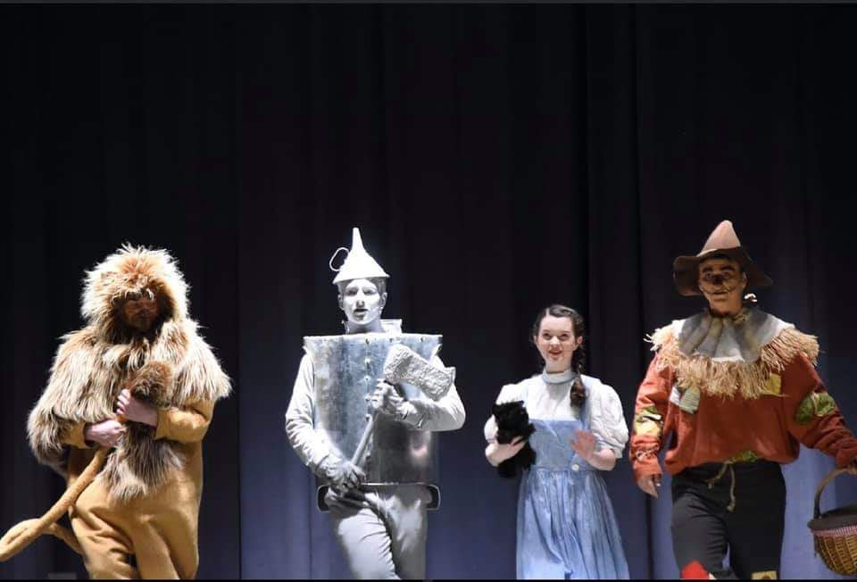 Todd Owen Howe, Jack Danko, Carrie Fuller, and Nathan Zetts play the Lion, Tinman, Dorothy, and Scarecrow.