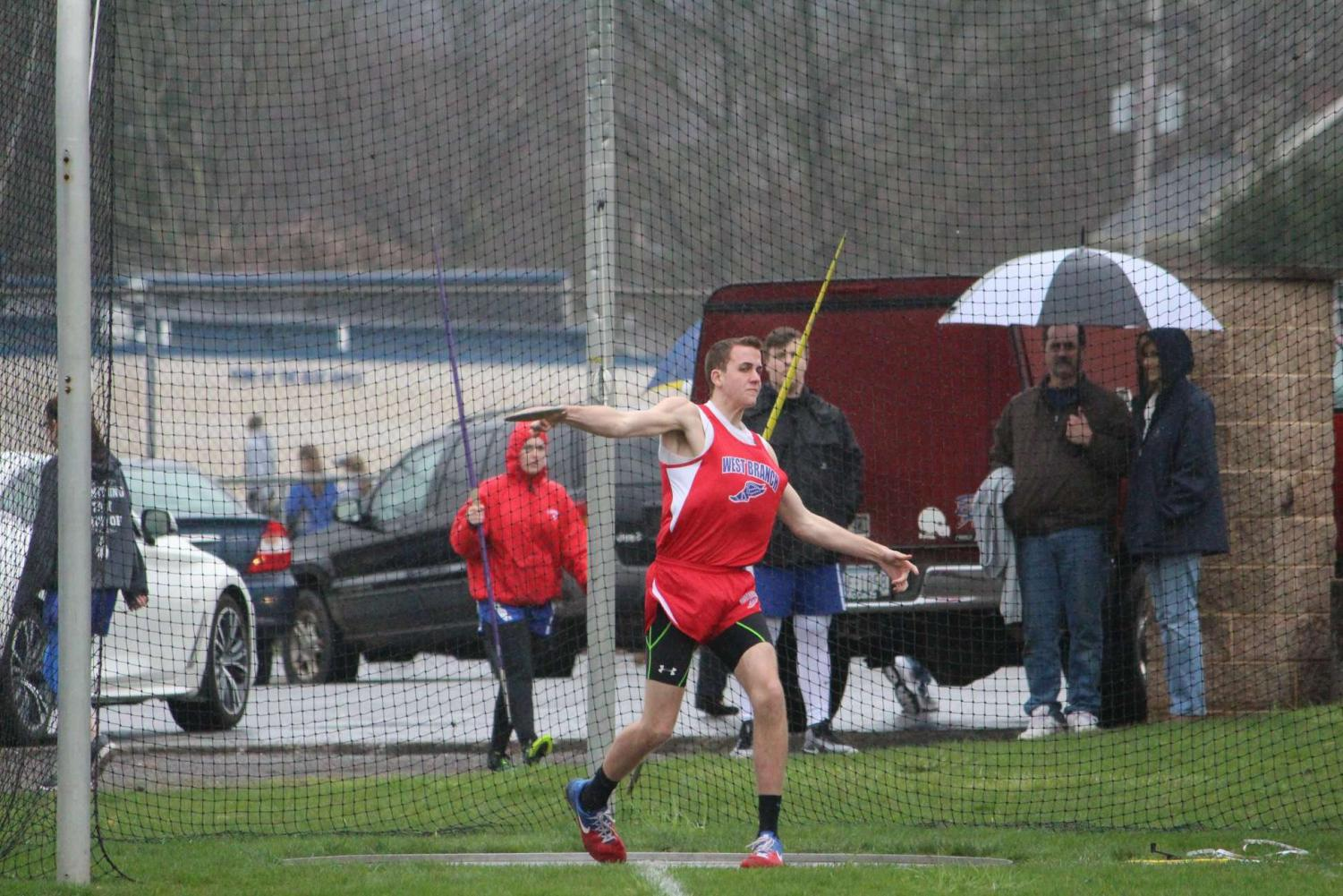 Larry winds up to throw a discus during a meet this season.