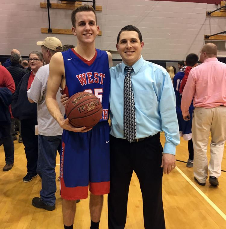 Larry+and+Coach+Clark+pose+for+a+picture+after+Larry+scored+his+1000th+point+during+the+final+game+of+his+Junior+year.