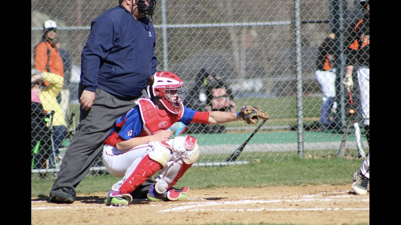 Eddie Dale frames a pitch during a game at Tyrone Area High School.
