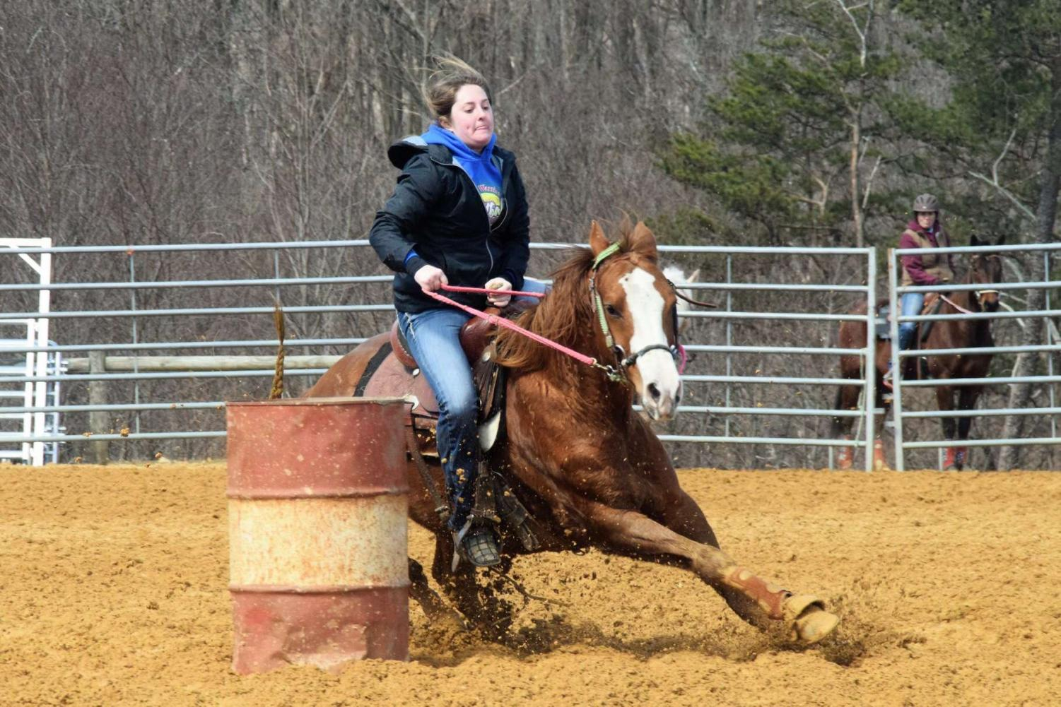 Sydney and her horse Duke round a barrel in a race. Dunlap won the barrel competition.