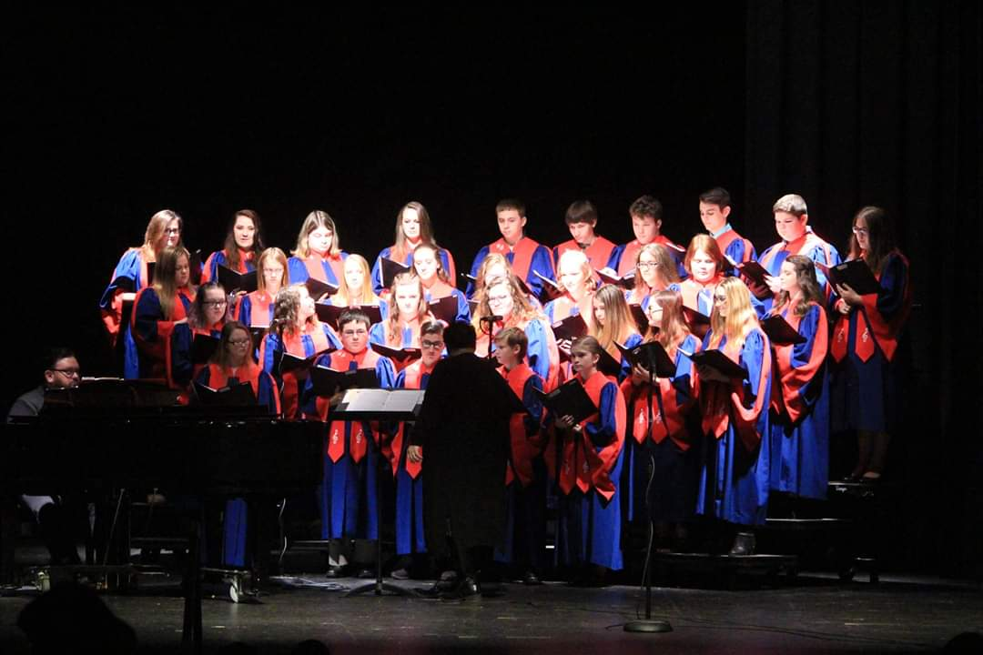 An action shot of the Sr High choir performing at the WB Christmas Concert.