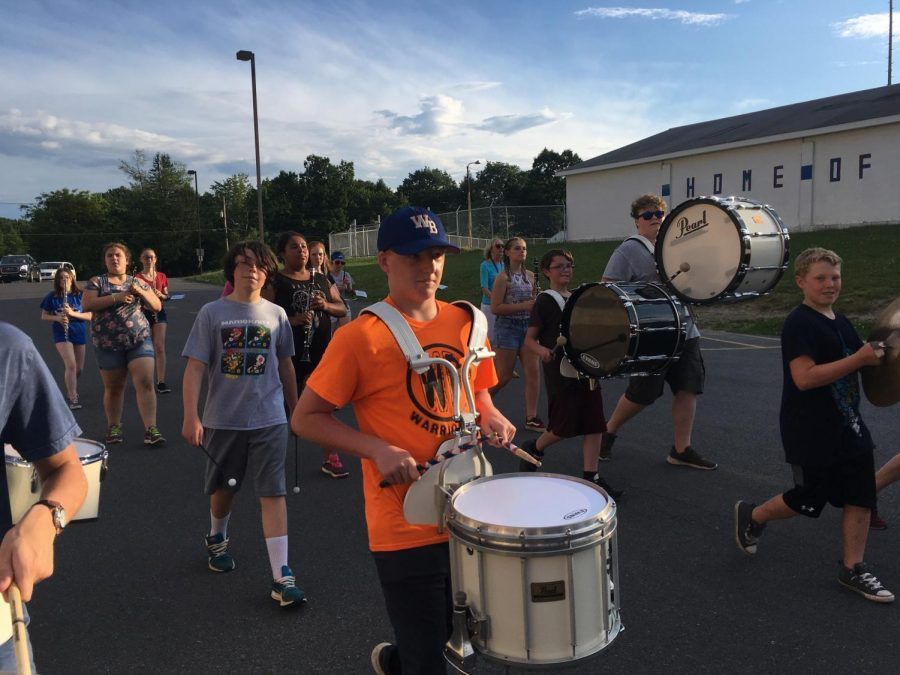 Our West Branch Warrior Marching Band marching around the school during practice.