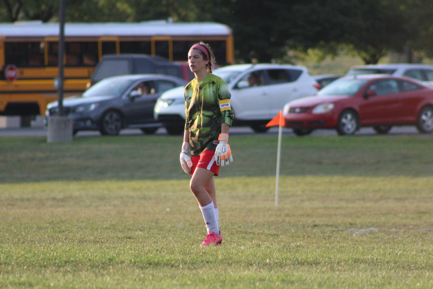 Sarah Betts watches as her defense kicks the ball to the other side of the field.