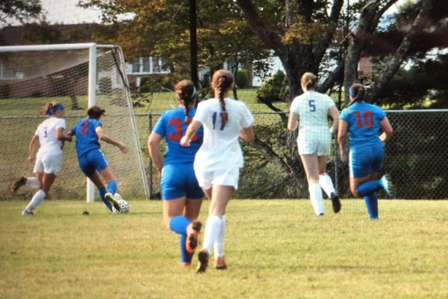 The Lady Warriors offense works past the opponents defense.