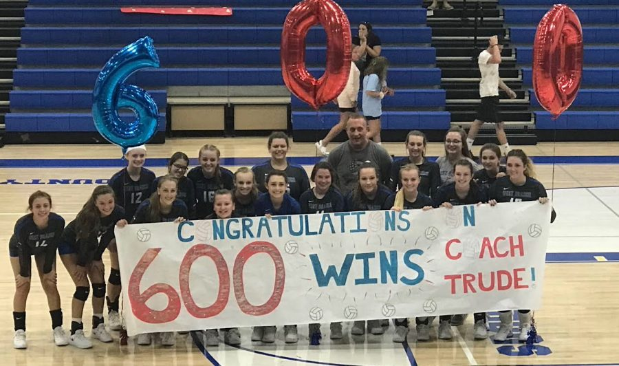 Coach Trude and his team celebrating his 600th win