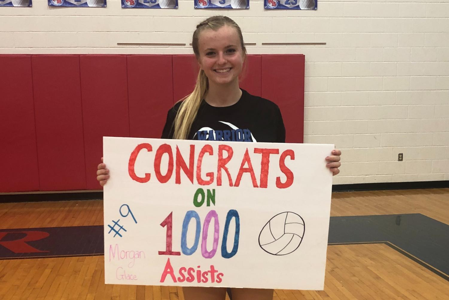 Morgan holding her sign made by her teammates.