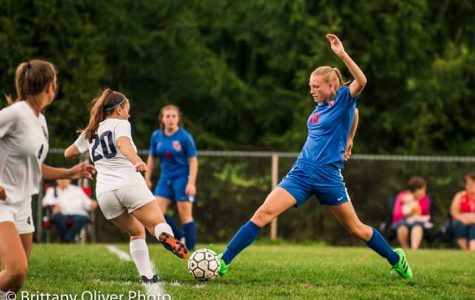 Madison Kephart steals the ball from an opponent.