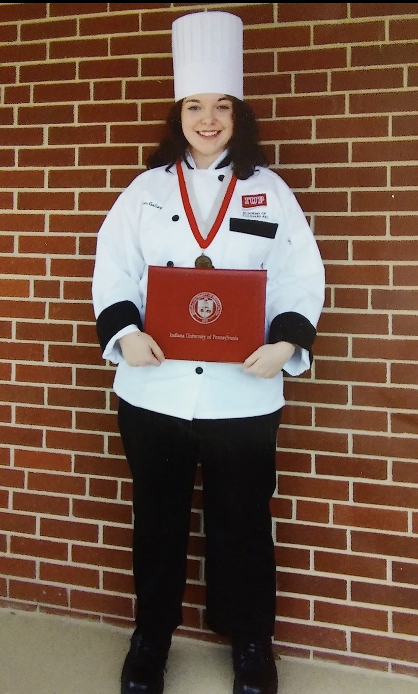Aspen Galley poses for a picture after graduating from Indiana University of Pennsylvania's culinary school.