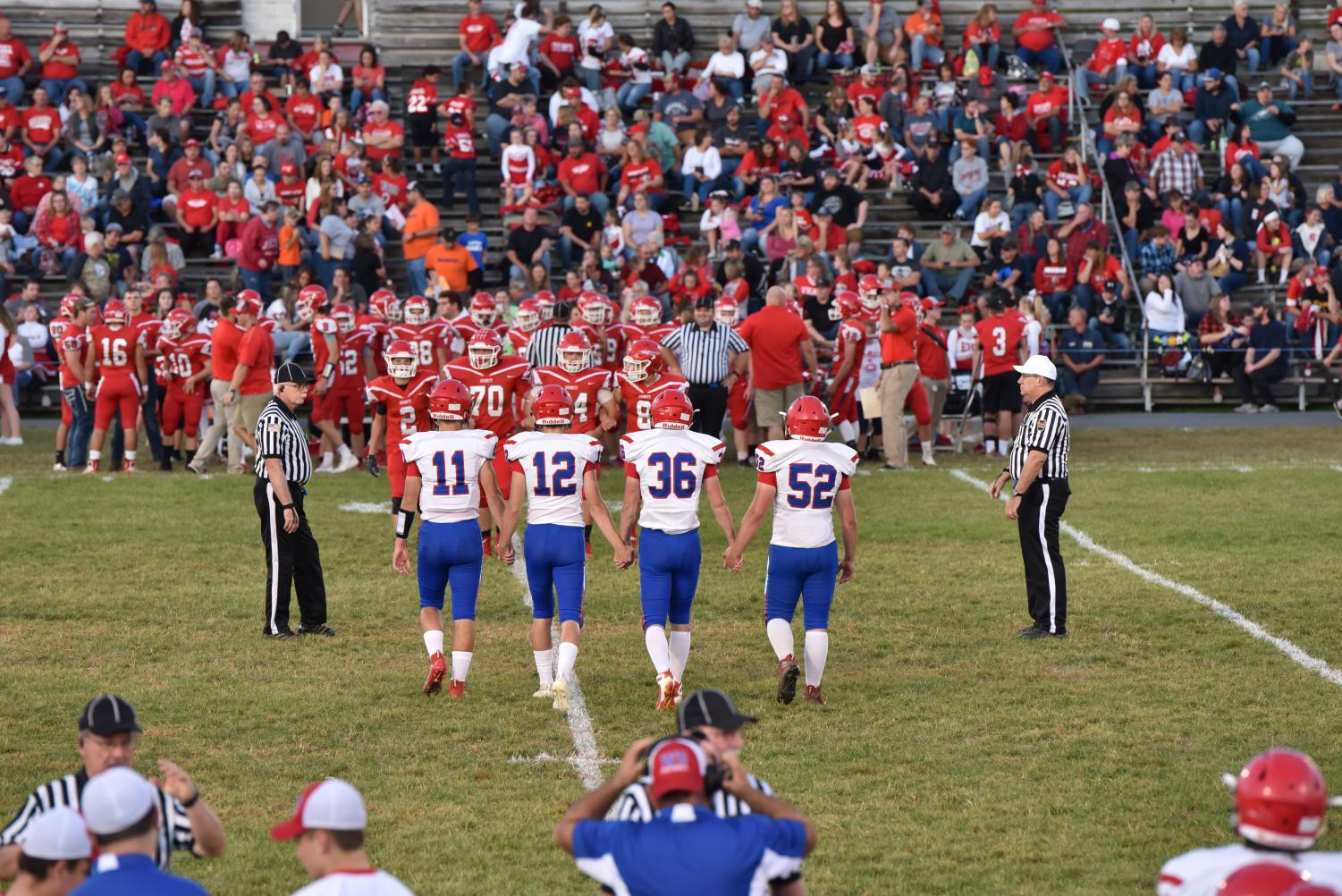 The West Branch captains walk onto the field for the captains meeting.