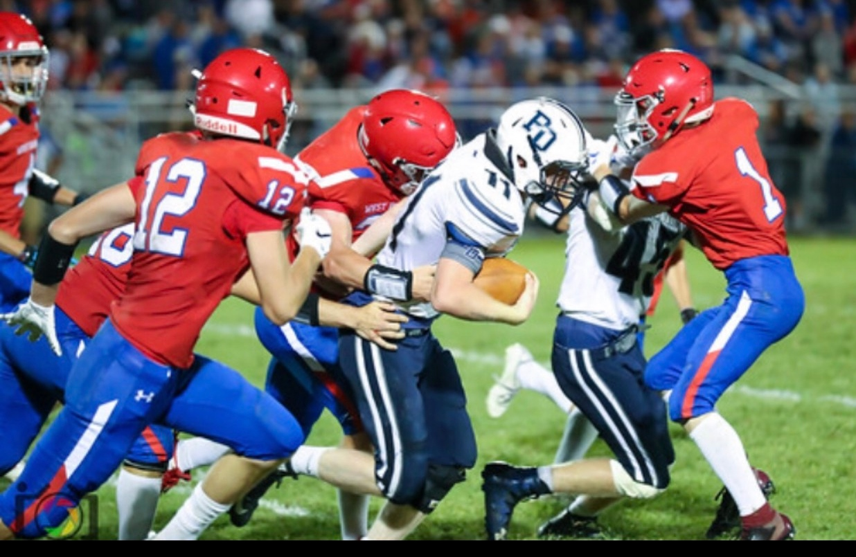 Picture of Aidan going after a PO football player