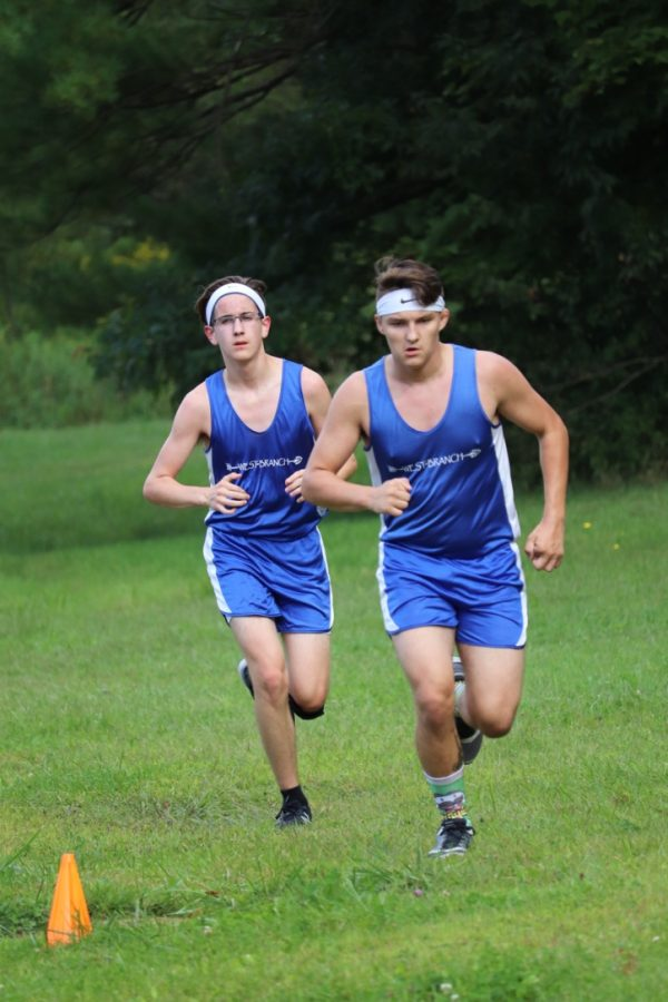 Hayes Jones and Thomas Kovalick run around the softball on the home course.