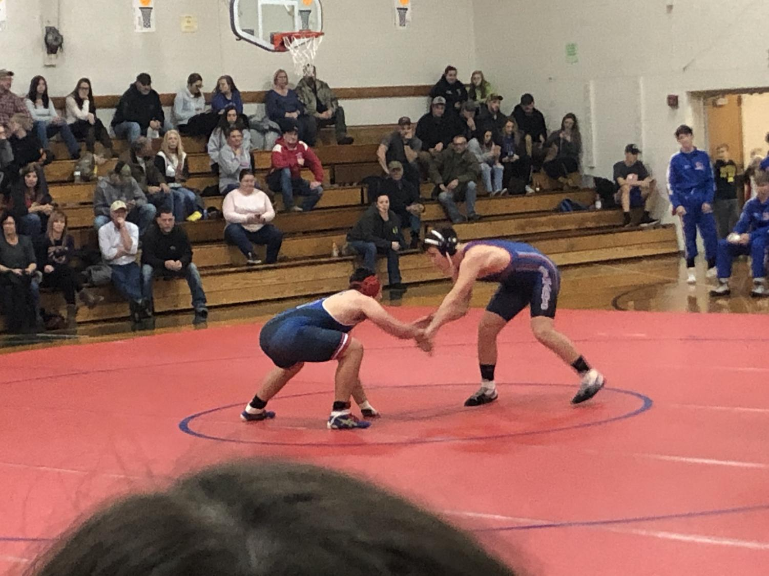 Warrior wrestler Ethan Yingling fights off the attack of the St. Mary's wrestler.
