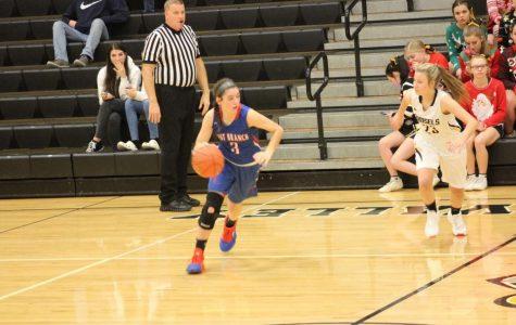Sarah dribbling past a defender.