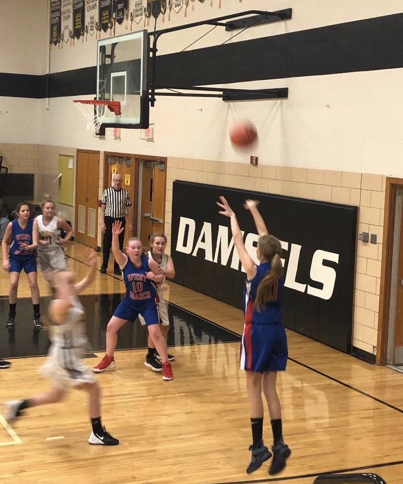 Jenna taking a shot from the corner against Moshannon Valley.