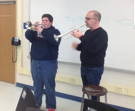Dr. Stowman and Noah Fry during the Trumpet sectional.