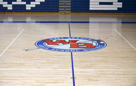 The school's logo sits at half-court on the new court design.