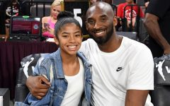 Kobe Bryant and his daughter Gianna sitting courtside at the 2019 WNBA All-Star Game.