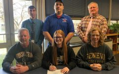 Elishea Reed signed her leter of intent to play softball at Geneva. Pictured with her are her parents, Mr. Williamson, Head Coach Dan Betts, and Mr. Holenchik.