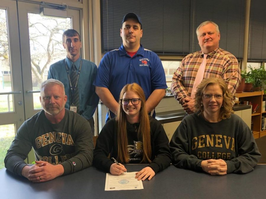 Elishea+Reed+signed+her+leter+of+intent+to+play+softball+at+Geneva.+Pictured+with+her+are+her+parents%2C+Mr.+Williamson%2C+Head+Coach+Dan+Betts%2C+and+Mr.+Holenchik.+
