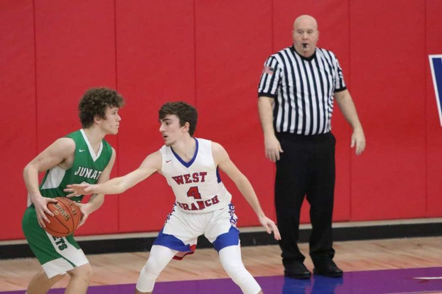 Chance defends the opposing player in a contest against Juniata Valley.