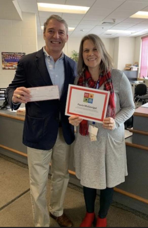 Mrs. McGonigal receives her MAC grant certificate from McDonald's representative, John Croyle.
