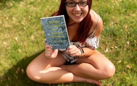 Kay posing with her latest book
