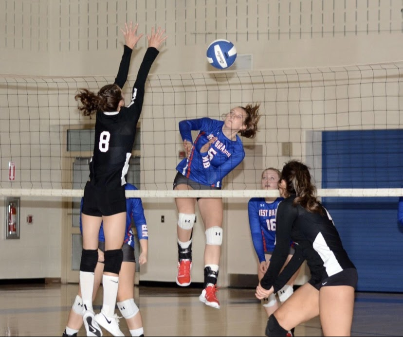 Junior Abby Gallaher going up for the kill.