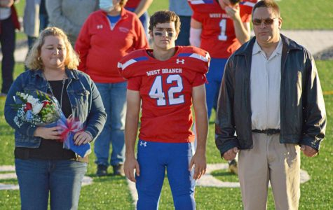 Noah Hoffner and parents during senior recognition ceremony