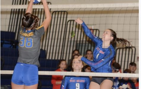 Taylor Myers appraoches the net for a kill.