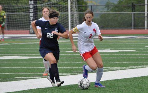 Trinity Prestash dribbles the ball past a PO defender