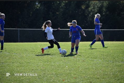 Lady Warriors centerback Eleyna Hanslovan dribbles the ball past a northern Bedford defender. Hanslovan helped to earn another shutout for the Lady Warriors.