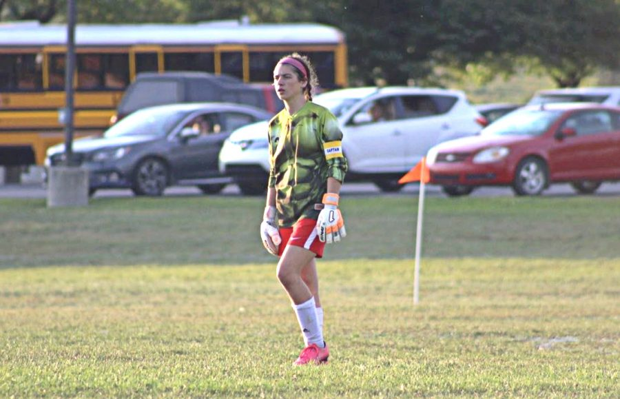 Sarah Betts analyzing the other team's strategy and encouraging her team during the game.