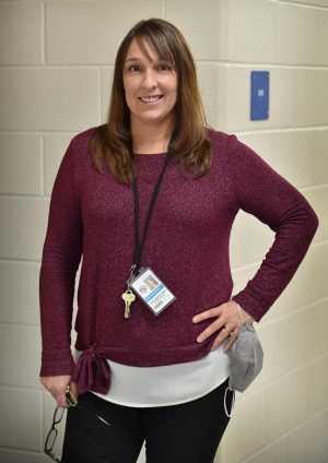 Mrs. Hanslovan poses for a photo before beginning a new school day.