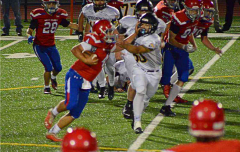 Ty Biggans attempting to rush the ball against the Black Knights.