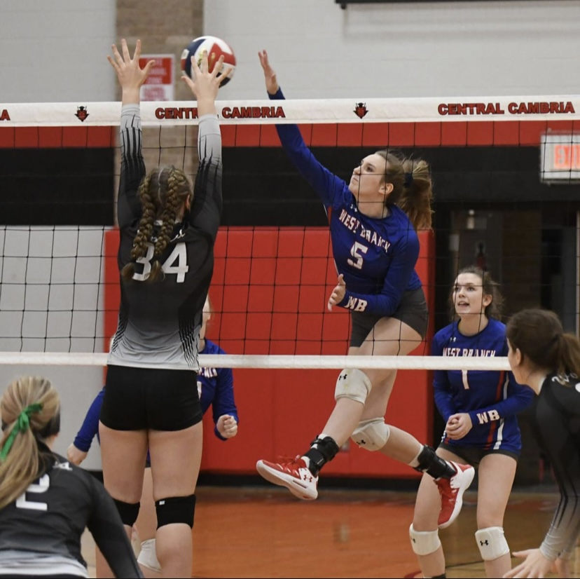 Junior Abby Gallaher going up for the kill against West Shamokin's' middle blocker.
