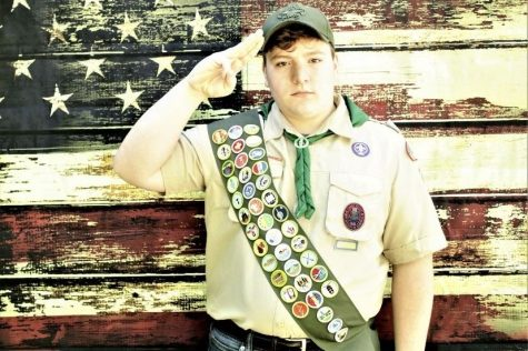 Jason poses for a photo in his Boy Scout uniform.