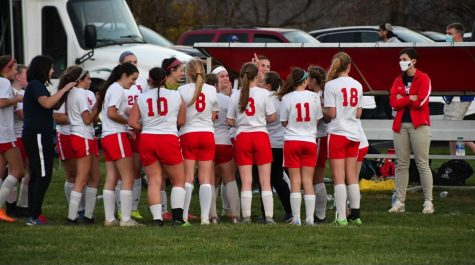 Lady Warrior Soccer team celebrate after winning their first state playoff game.