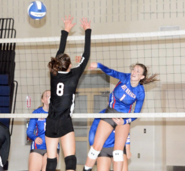 Senior Taylor Myers going up for the kill against a strong middle block.
