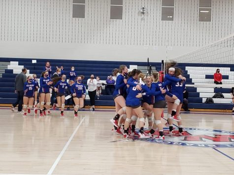 The Lady Warrior Volleyball team celebrate their district semi-final victory over Homer Center.