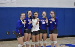 All five WB seniors posing for a photo following their fourth consecutive ICC championship win.