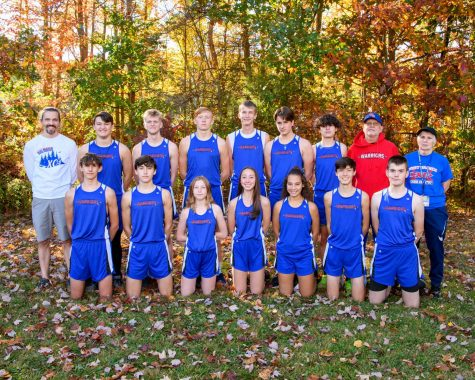 West Branch Cross Country team smiles for a photo.