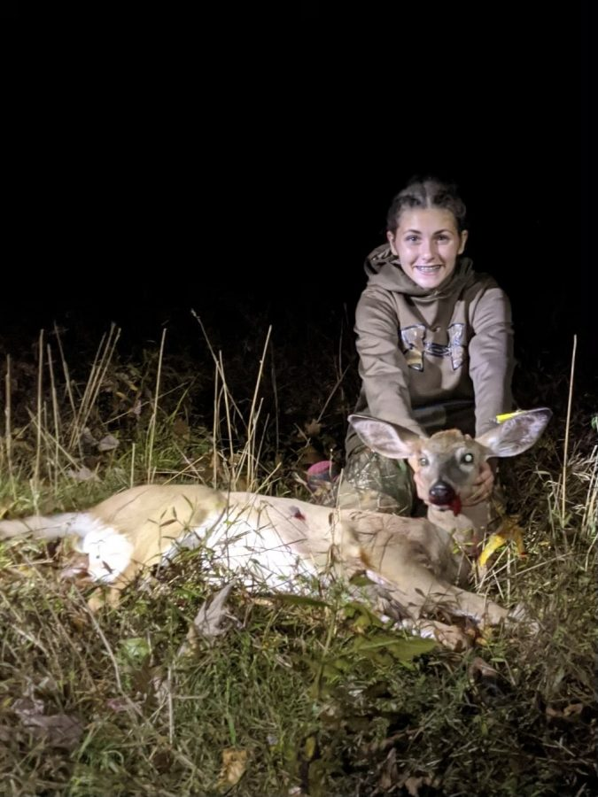 Sydney Yontosh posing for a photo with a beautiful doe she harvested this hunting season.