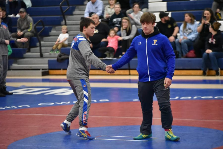 Ethan Yingling shaking the hand of his opponent after the match