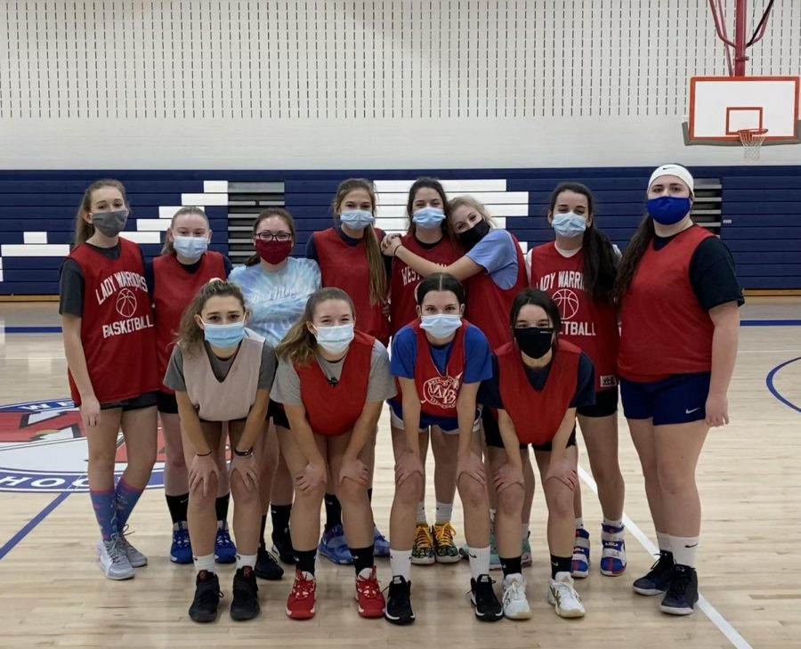 The Lady Warriors pose for a photo at the last practice before their first game.